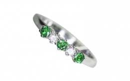 Ring with emeralds and diamonds